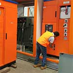 Another engineer testing and commissioning a kiosk substation