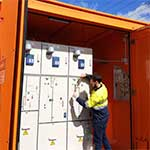 Engineer testing and commissioning a kiosk substation designed by Teck Global